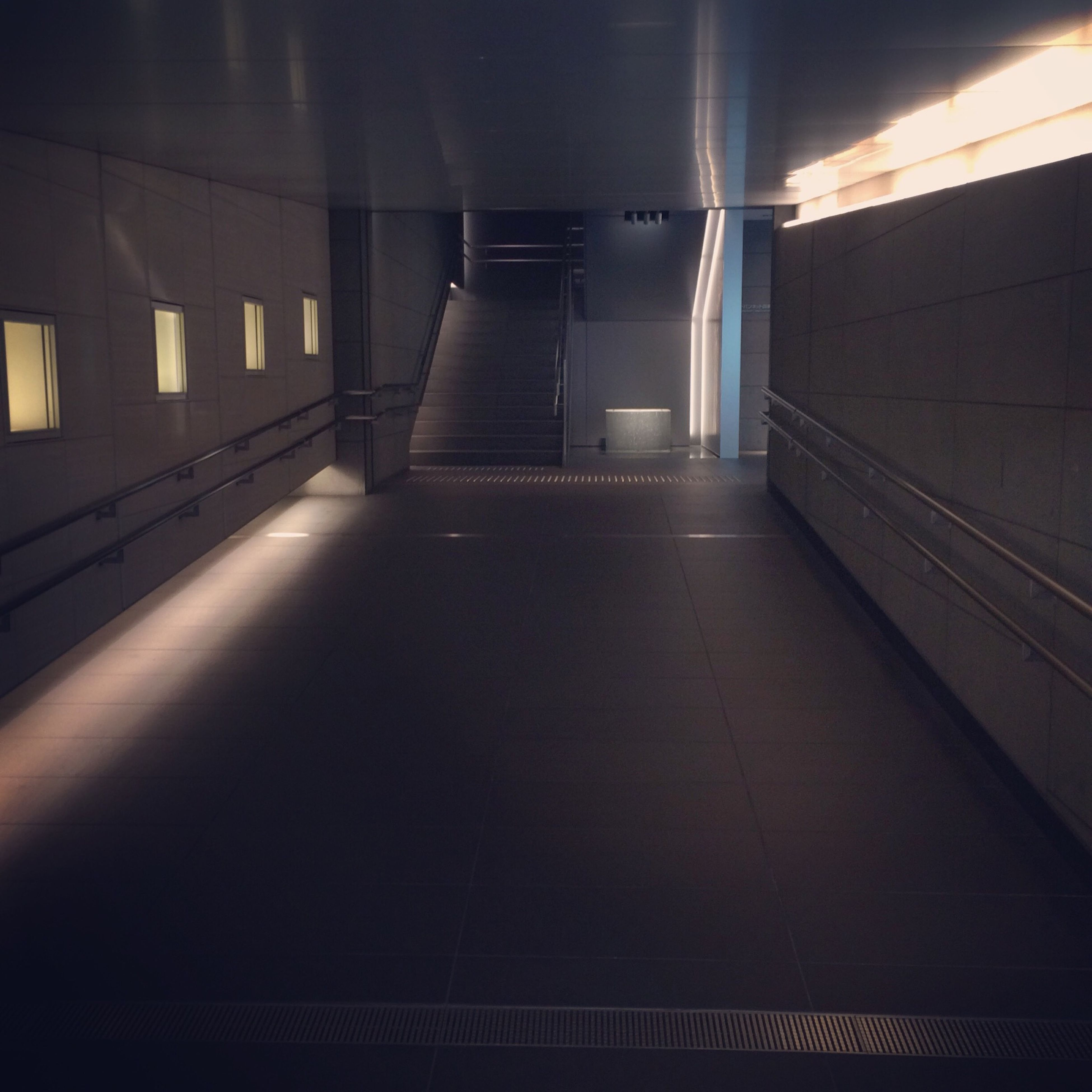 indoors, architecture, built structure, illuminated, empty, ceiling, absence, corridor, tiled floor, the way forward, flooring, lighting equipment, modern, building, interior, railing, diminishing perspective, reflection, no people, sunlight