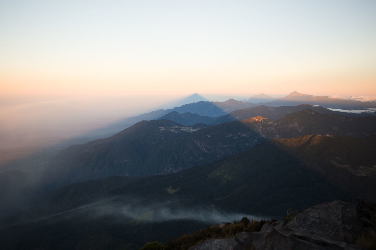 The shadow of Santa Maria volcano at sunrise, Guatemala Beauty In Nature Dawn Day Landscape Mountain Mountain Range Nature No People Outdoors Scenics Shadow Sky Sunrise Sunset Tranquil Scene Tranquility Volcano