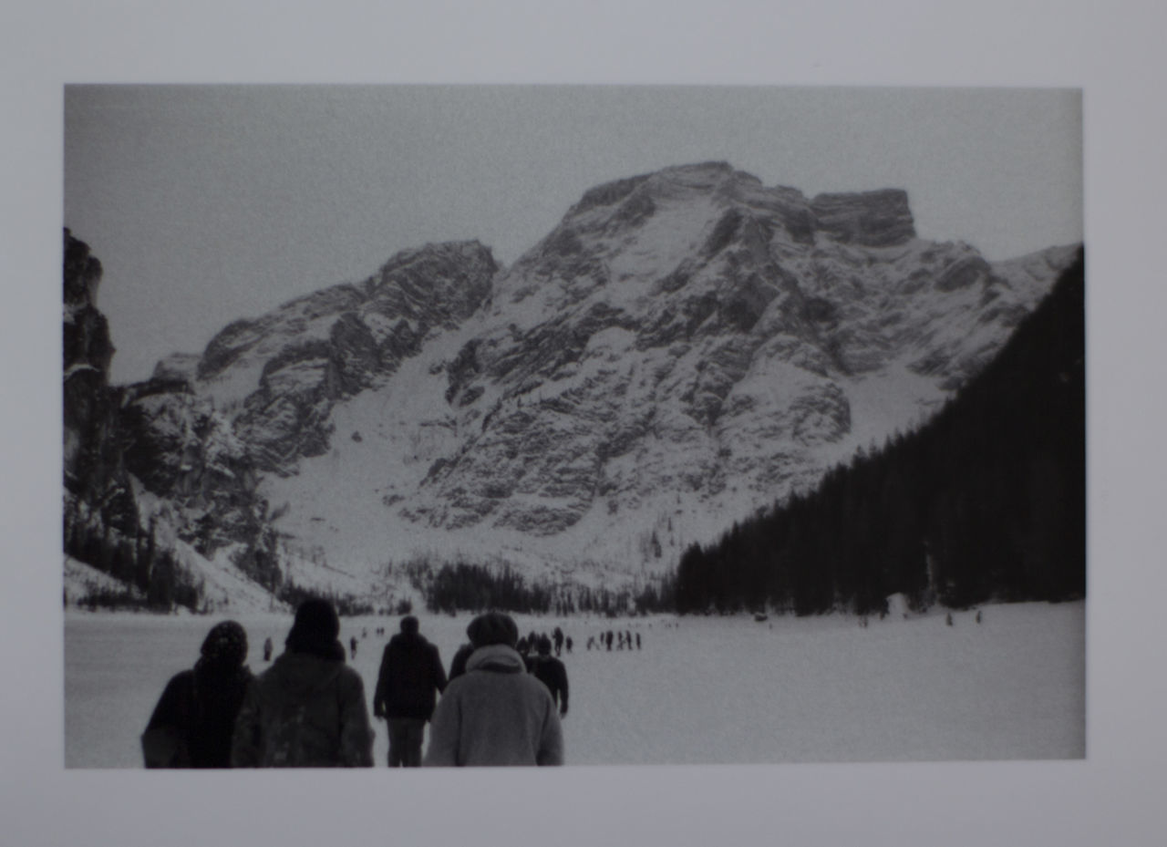 People On Snow Against Snowcapped Mountain
