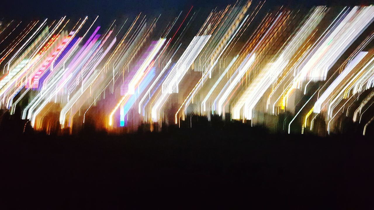 night, illuminated, long exposure, multi colored, speed, motion, arts culture and entertainment, outdoors, nightlife, no people, sky, nature