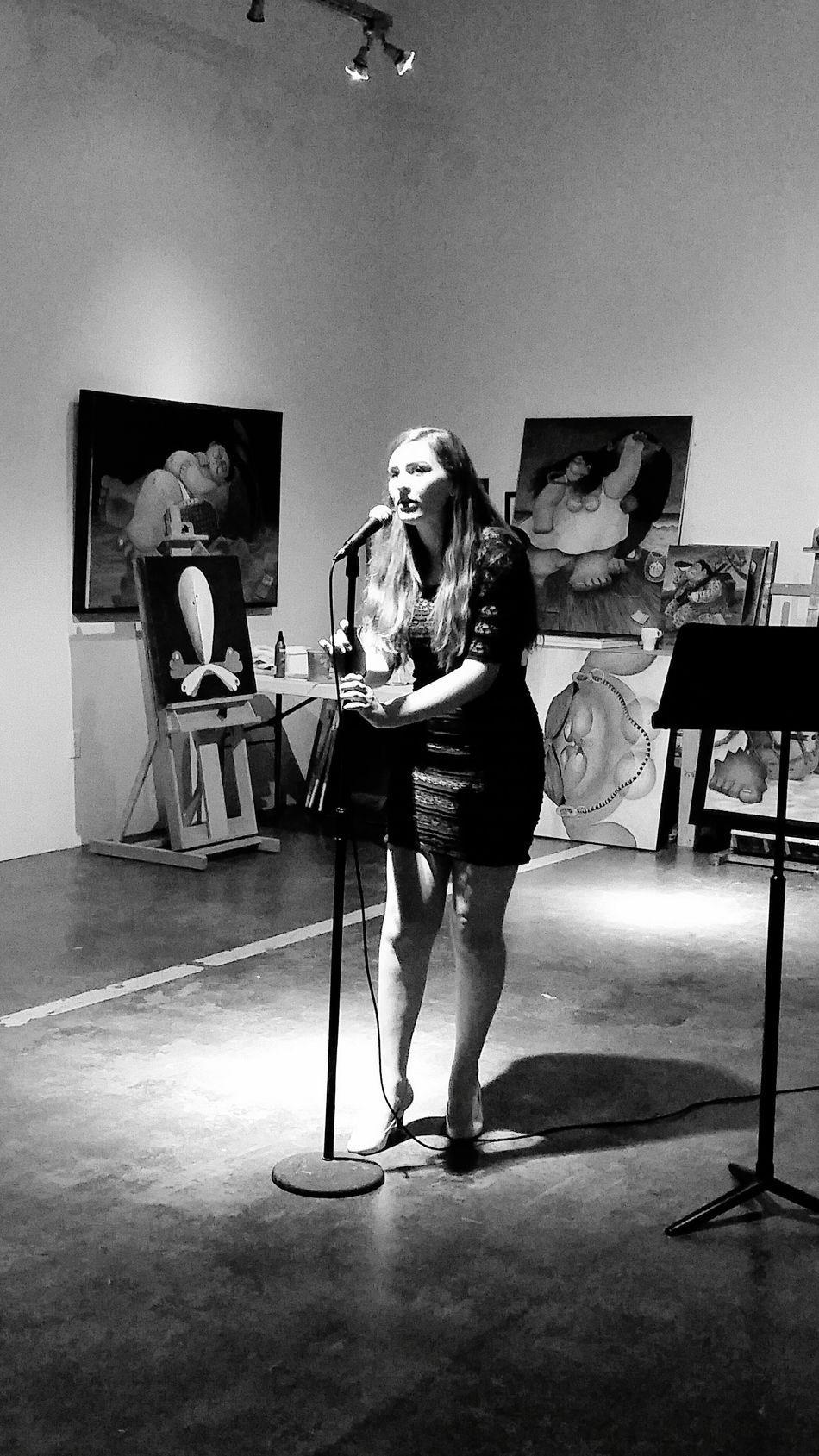 Full Length Young Adult Well-dressed Person Recital Sing Voice Vocalist Vocal Singer  Art Artist Studio Standing Microphone Black And White Mic