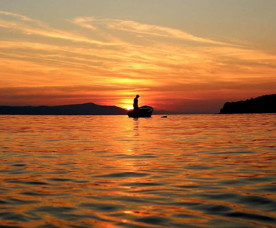 Sunset Silhouette Reflection Orange Color One Person Water Dusk People Outdoors One Man Only Floating On Water Lake Sky Beauty In Nature Adult Nature Only Men Scenics Night Adults Only