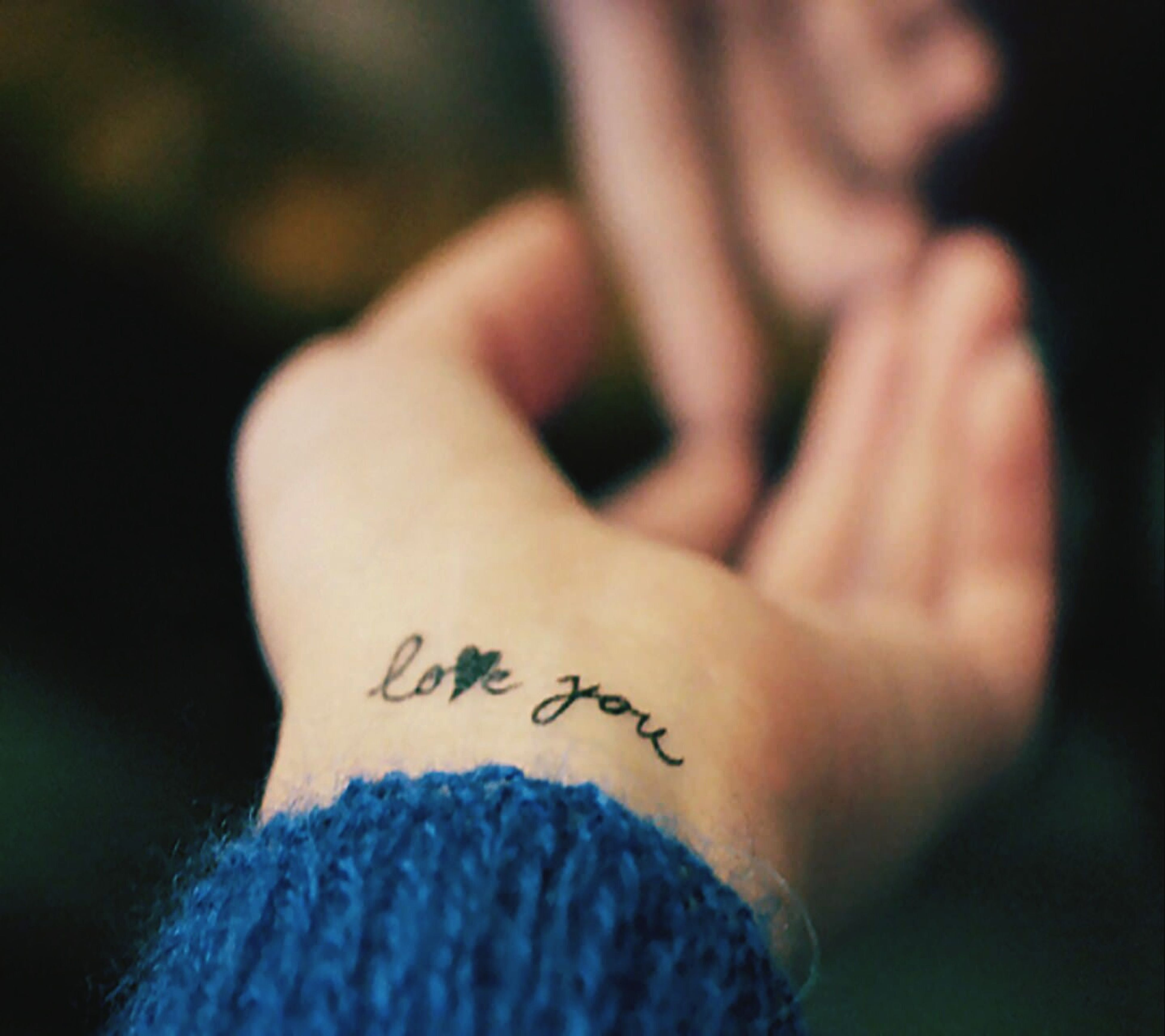 person, part of, text, human finger, close-up, unrecognizable person, western script, cropped, indoors, lifestyles, communication, men, holding, selective focus, personal perspective, leisure activity