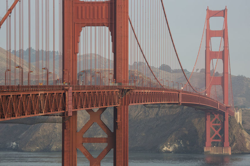 Golden Gate Bridge Close-up view at clear morning California Clear Sky Golden Gate Bridge Point Of Interest San Francisco Architecture Bridge Bridge - Man Made Structure Built Structure Chain Bridge Connection Day Engineering Landmark Mountain No People Outdoors Red Sky Suspension Bridge Tourism Transportation Travel Travel Destinations Water