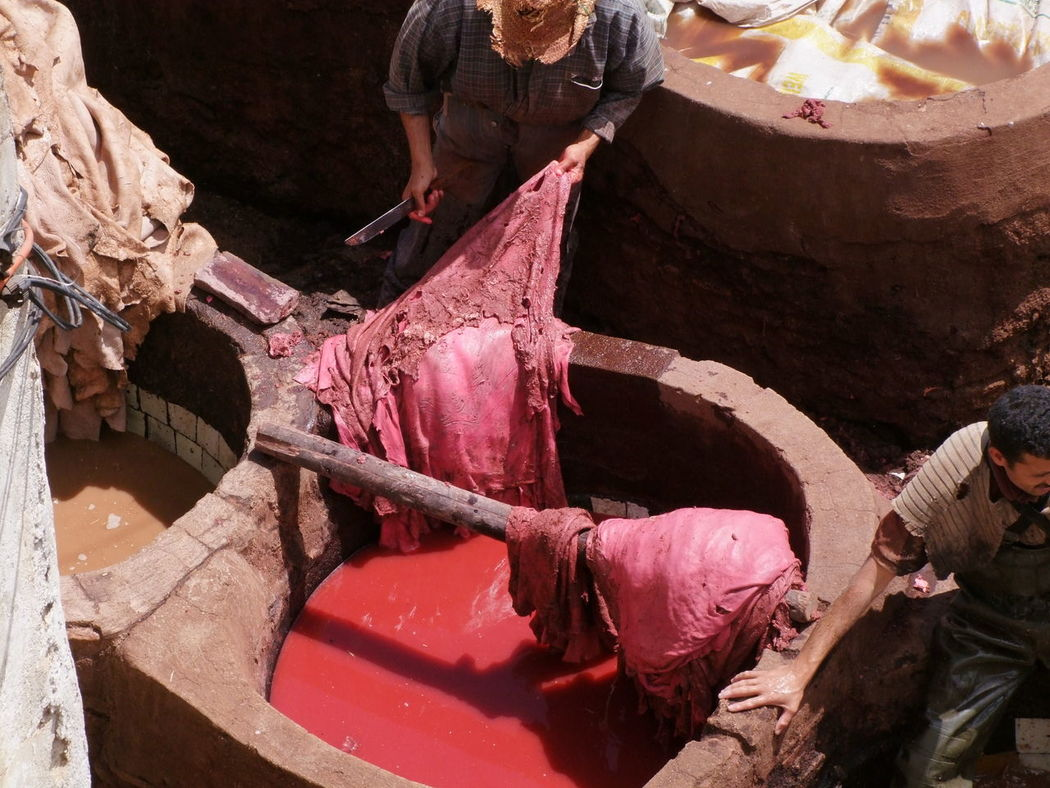 Colouring Leather Red in the Tannery, Medina City Close Up Colouring  Composition Dyeing Famous Place Fes Full Frame High Angle View Leather Making A Living Medina Medina De Fez Morocco Outdoor Photography Red Colour Red Dye Skins Smelly Sunlight And Shadow Tanner Tourist Attraction  Tourist Destination Treating Workmen