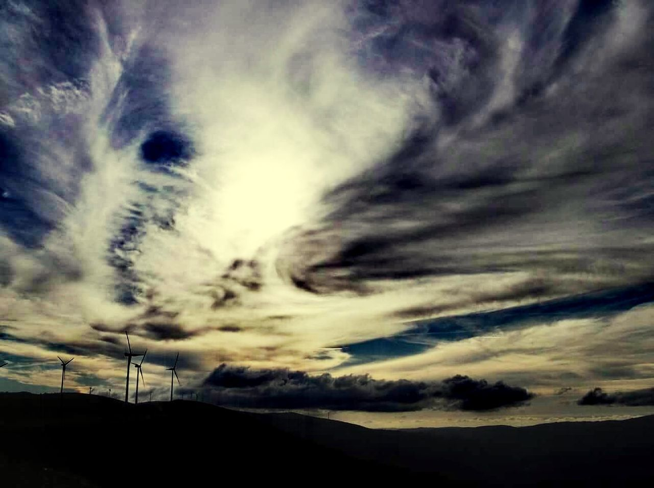 cloud - sky, sky, scenics, nature, tranquil scene, beauty in nature, majestic, dramatic sky, sunset, tranquility, no people, landscape, outdoors, low angle view, awe, silhouette, mountain, day, vapor trail