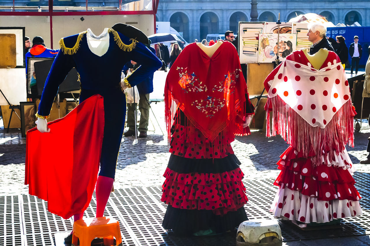 Traditional bull fighting and flamenco costumes in Plaza Mayor in Madrid. Bull Fighter City Clothing Costume Costumes Day Destination Dress Editorial  Fashion Flamenco Hanging People Red Red Street Tourism Tourism Destination Travel