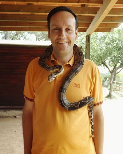 Place: Centre d'apropament a la natura. Animal: Boa constrictor. Animal Themes Nature Catalunya Snake Boa Only Men One Man Only One Person Looking At Camera Smiling