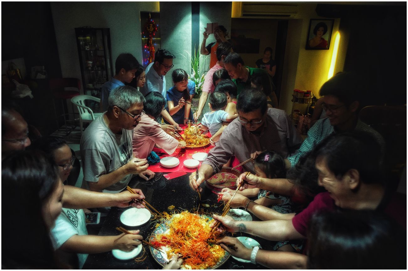 Lifestyles Real People Large Group Of People Women Leisure Activity Sitting Eating Indoors  Togetherness Food Men Crowd Day Reuniondinner Family Gathering Louhei CNY2017 CNY Singapore The time of the year where everyone gather together and 捞 together