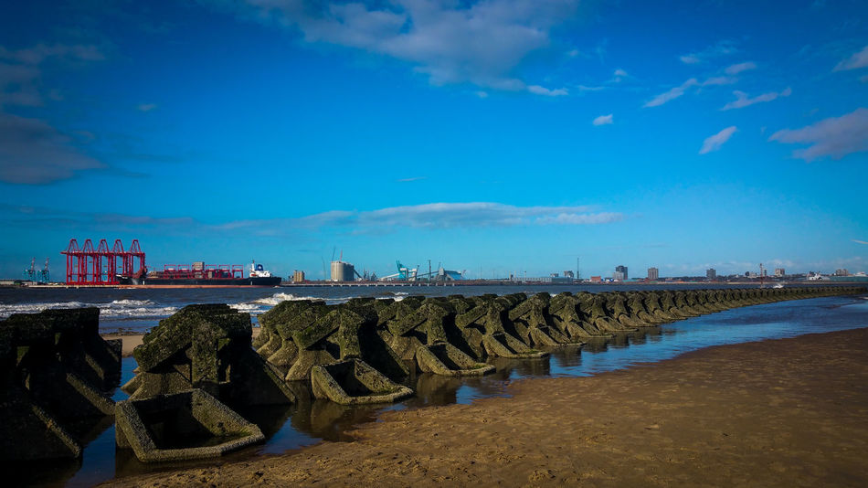 Beach Beachphotography Beauty In Nature Blue Sky Day Docks Harbor Horizon Over Water Large Group Of Objects Liverpool Low Tide New Brighton No People Outdoors Sea Sea Breaker Sea Wall Sky Water Wirral Wirral Peninsula