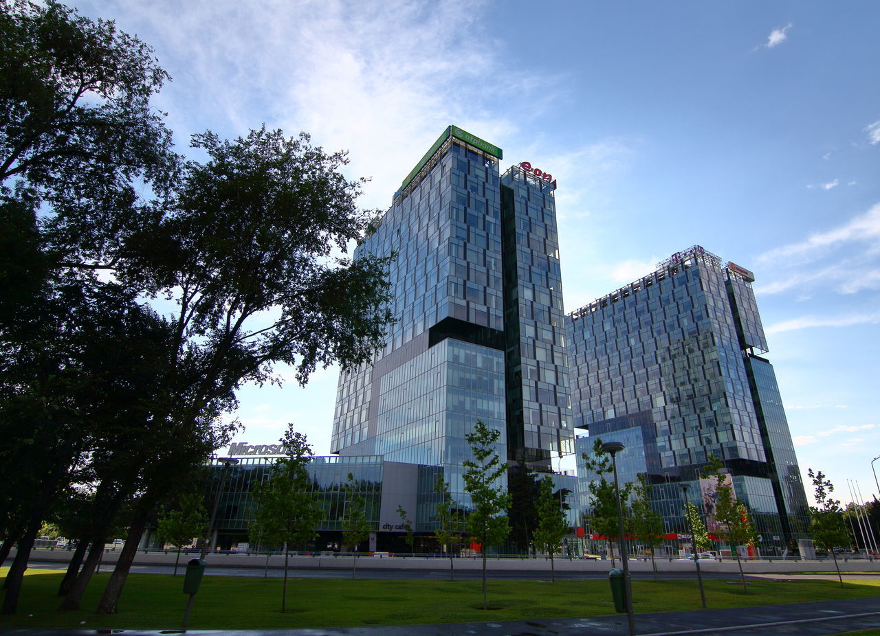 Bucharest, Romania - June 17, 2017: View of Microsoft Romania headquarters in City Gate Towers situated in Free Press Square, in Bucharest, Romania. June 17, 2017 Architecture Architecture; Bucharest; Bucuresti; Building Buildings City City Gate South Tower City Gate Towers Cityscape Cloudy Sky Edifice Free Press Square Landmark Microsoft Headquarters Microsoft; Office Office Block Office Building Offices Outdoor Romania Structure Tourism Urban