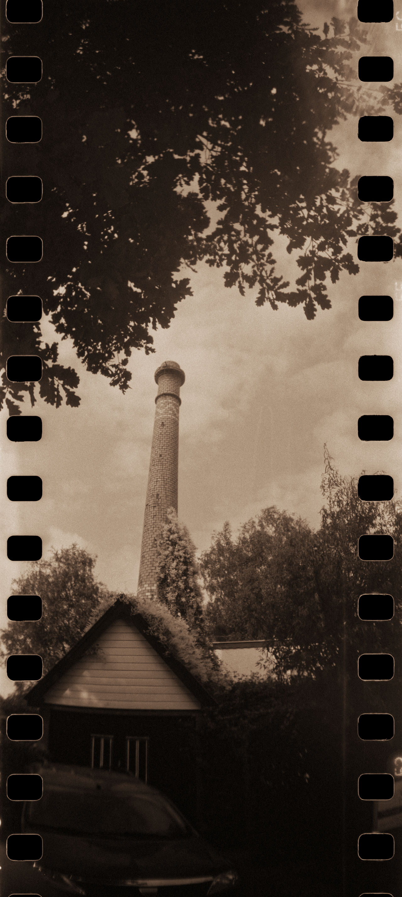 Tall Against the Sky 35mm 35mm Film Analog Black & White Blackandwhite Bricks Brickwork  Car Cloud Factory Film Fomapan400 Historical History House Lomography Masonry Panorama Rodinal Sky Sprocket Sprocket Rocket Panorama Tower Tree Urban