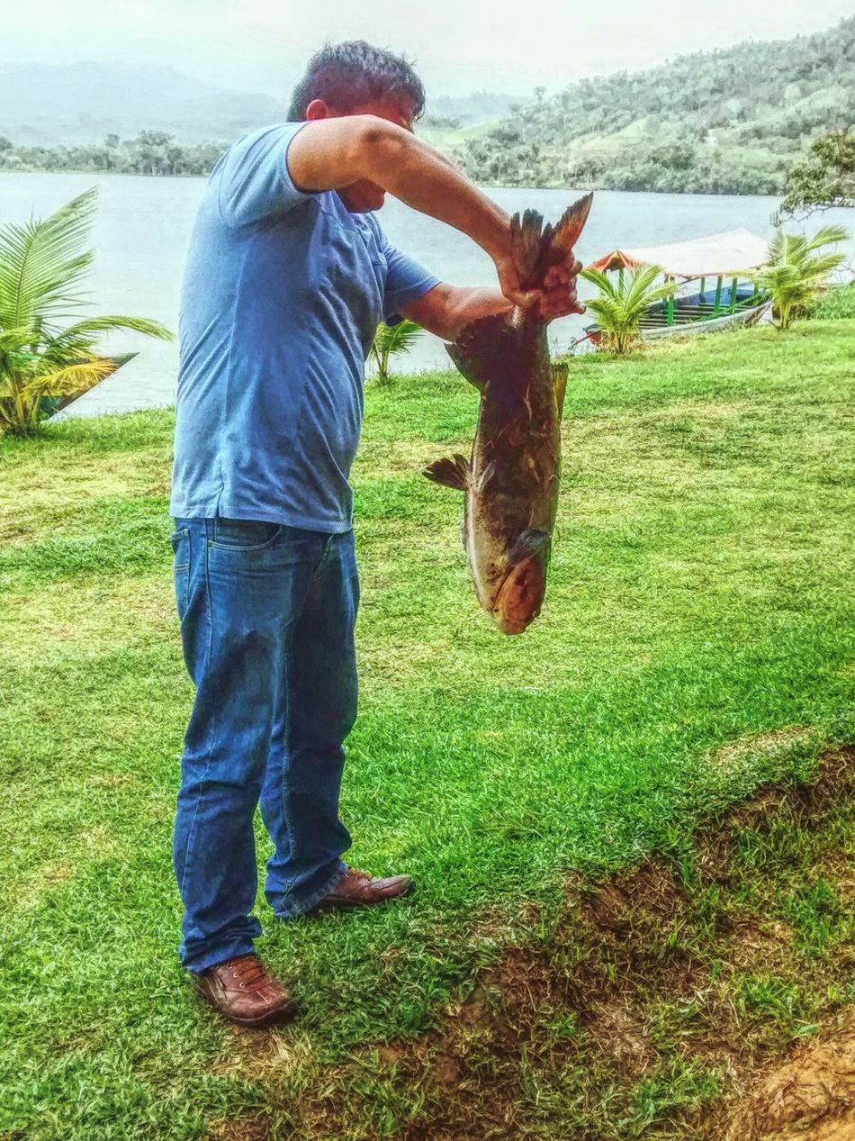 Poor fish... 😐😑😶😟 One Person One Animal Day Fishing Activity Lake Real People Lifestyles Adult Trip In Peru Jungle Trip Walking Around Taking Pictures Eye4photography  Tourist Popular Photos Outdoors People And Places