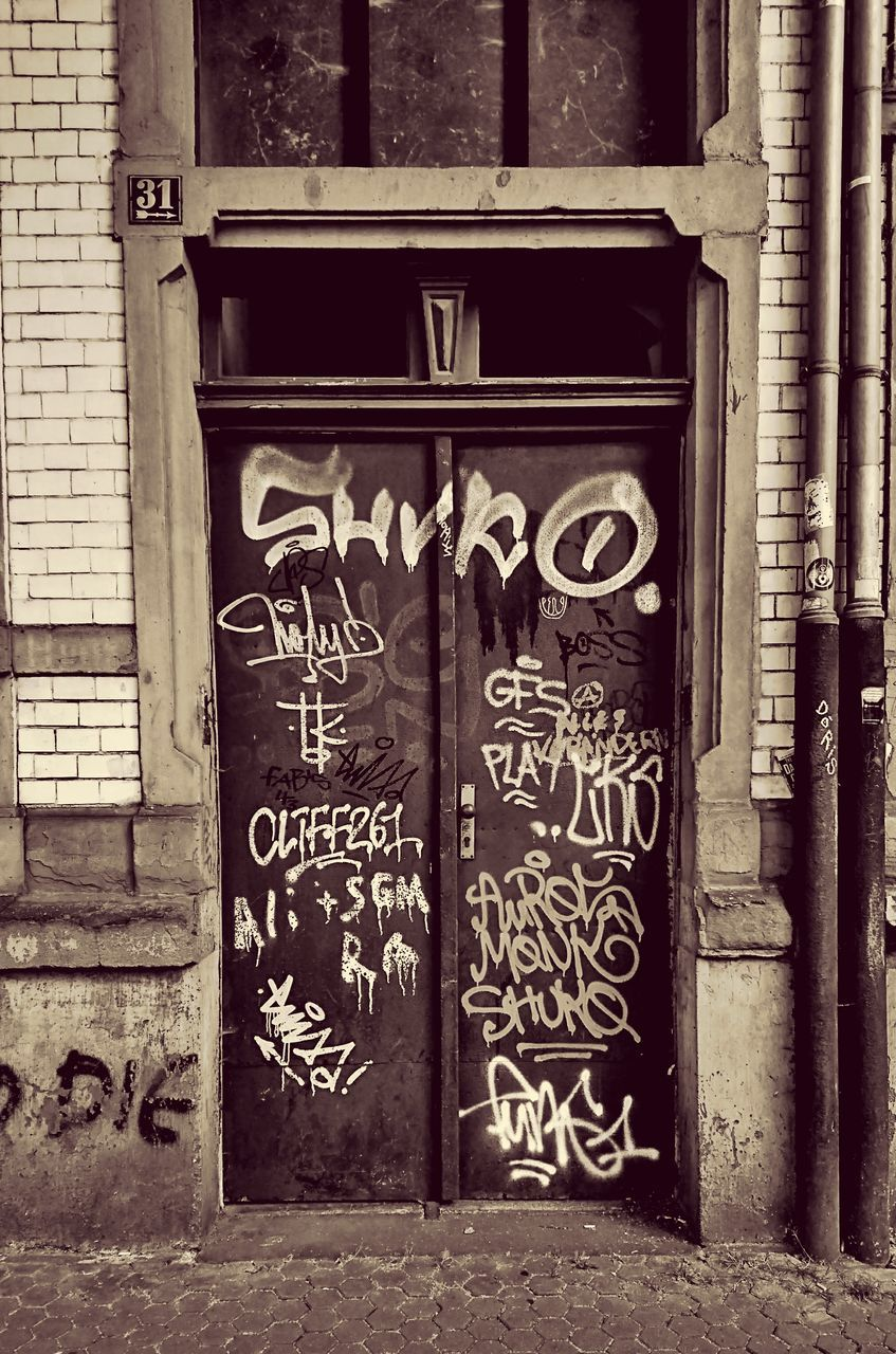 graffiti, text, built structure, architecture, building exterior, door, outdoors, day, no people