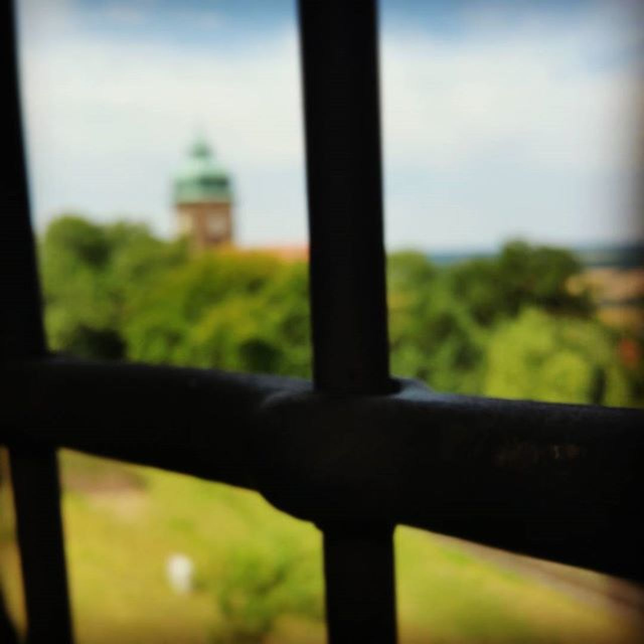 gate, focus on foreground, prison, no people, day, sky, outdoors, close-up