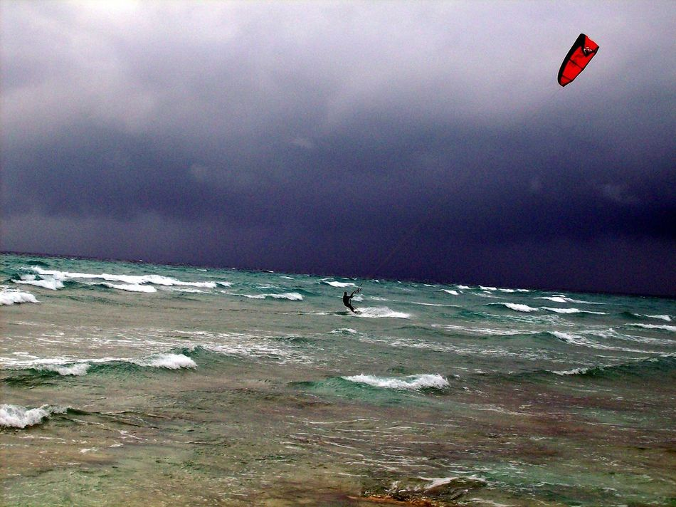 Beach Beauty In Nature Cloud - Sky Day Extreme Sports Flying Horizon Over Water Kitesurfing Leisure Activity Motion Nature One Person Outdoors People Real People Scenics Sea Sky Stormy Tranquility Water Wave Waves