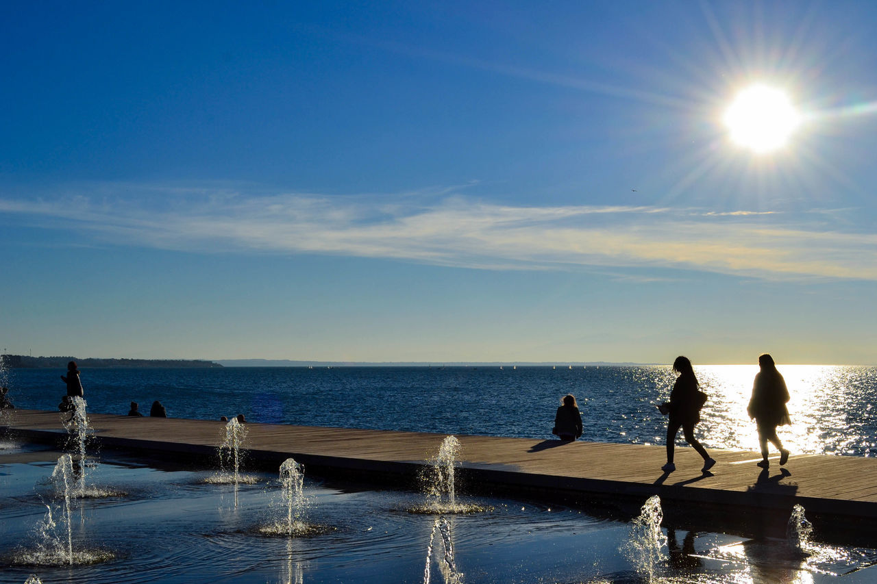 When the streets are close to the sea Thessaloniki Salonicco Greece Grecia City Sea Fountain Reflection Water Sky Silhouette Sunlight People Outdoors Day Horizon Over Water The Street Photographer - 2017 EyeEm Awards