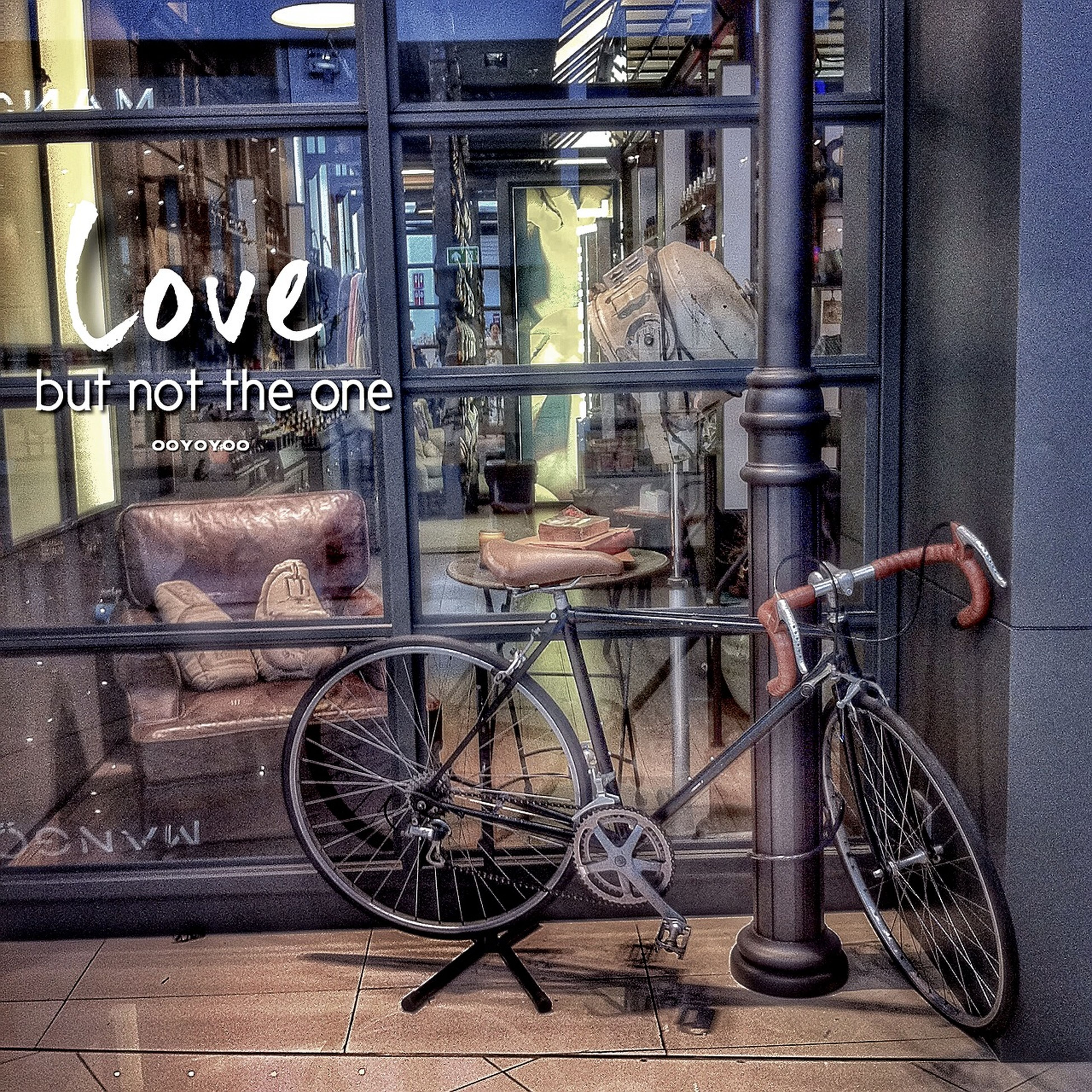 bicycle, stationary, architecture, built structure, parked, building exterior, parking, wall - building feature, mode of transport, window, transportation, land vehicle, house, wall, no people, day, indoors, sidewalk, door