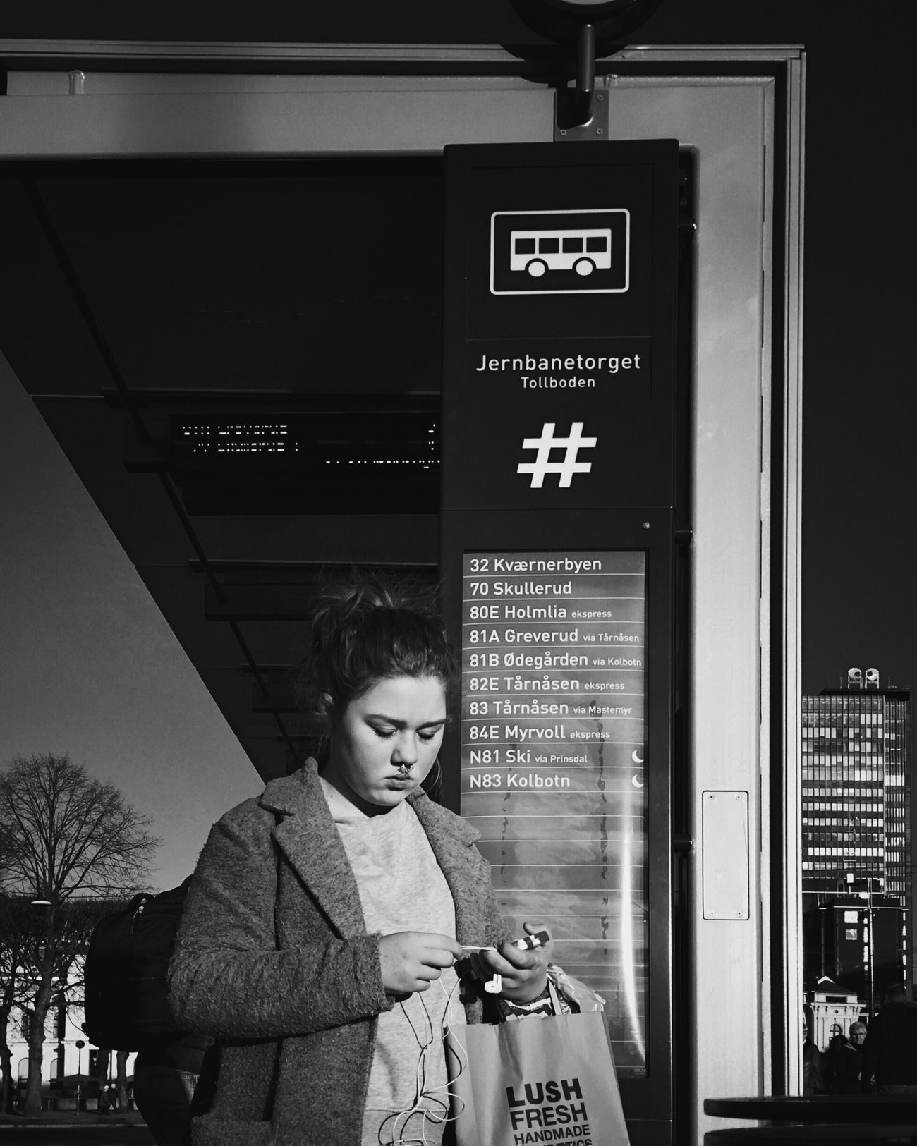 Meeting point • Oslostreets Streetphotography Street Streetphoto_bw Streetsofoslo Streetbwcolor Black & White Information Sign One Person Waiting