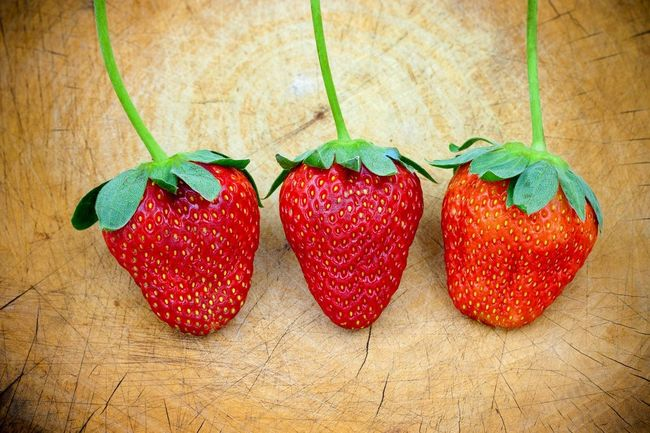 Strawberry on wood background. Strawberry Fruit Fruits Red Nutrition Three Healthy Vitamins