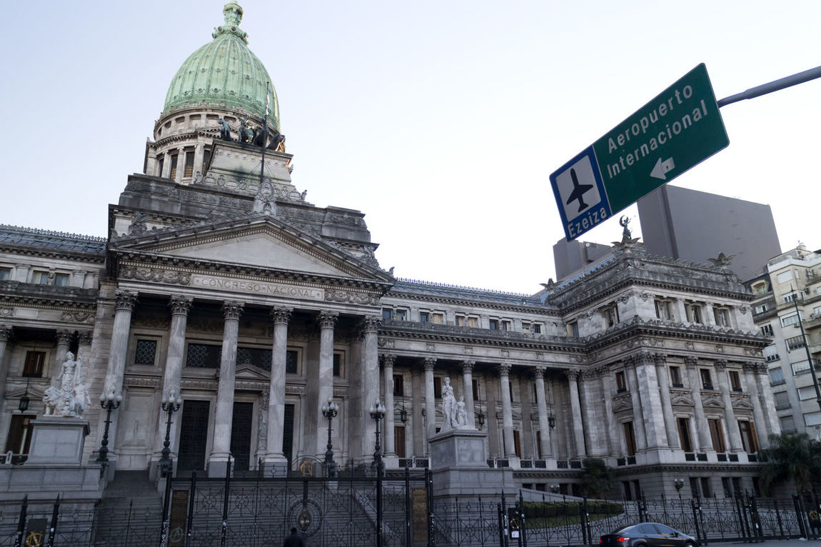 The Palace of the Argentine National Congress (Spanish: Palacio del Congreso Nacional Argentino, is a monumental building located at the western end of Avenida de Mayo (at the other end of which is located the Casa Rosada). The Kilometre Zero for all Argentine National Highways is marked on a milestone at the Congressional Plaza, next to the building. The Congress of the Argentine Nation is the legislative branch of the government of Argentina. Its composition is bicameral, constituted by a 72-seat Senate and a 257-seat Chamber of Deputies. Architecture Argentina Avenida De Mayo Avenida De Mayo Buildings Buenos Aires Buenos Aires Buildings Buenos Aires Citytour Buenos Aires Emblematic Places Buenos Aires, Argentina  Building Exterior Built Structure Clear Sky Congress Congress Building Day Dome Goverment Building History Low Angle View Outdoors Sky Tourist Attraction  Tourist Destination Travel Destinations