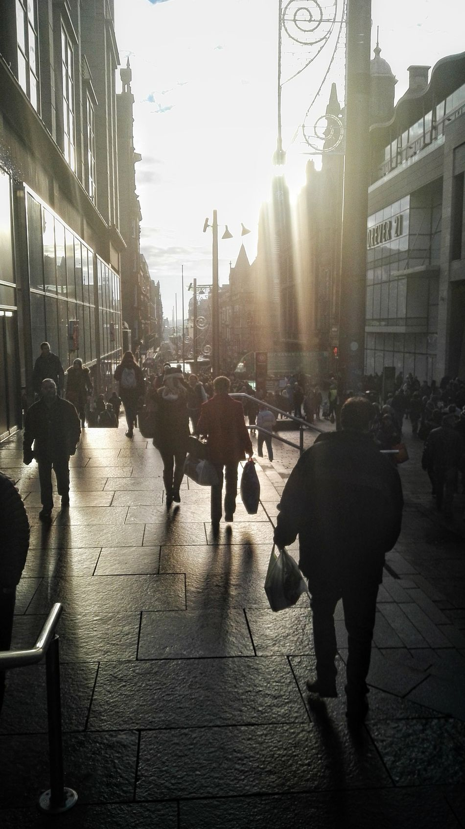 City Street City Street Sunlight City Life Walking Building Exterior Built Structure Shadow Large Group Of People Outdoors People Architecture Business Men Adults Only Adult Day Only Men