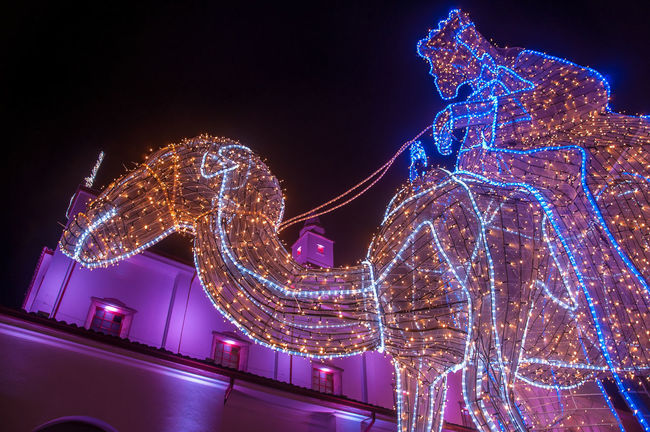 A lit up camel with a church behind it Architecture Bogota,colombia. Bogotá Built Structure Camel Capital Catholic Christian Christmas Church City Colombia December Decoration Illuminated Monserrate Monument Nativity Night Outdoors Religion Tourism Traditional Travel View