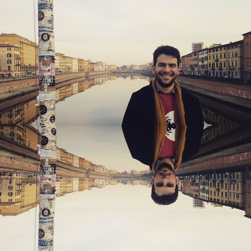 Reflections Seriousface Smiling Face Portrait Travel One Man Only Looking At Camera Adults Only Only Men Travel Destinations City Young Adult Cheerful Tourist One Person Happiness Vacations Architecture Smiling Outdoors Adult People Cityscape