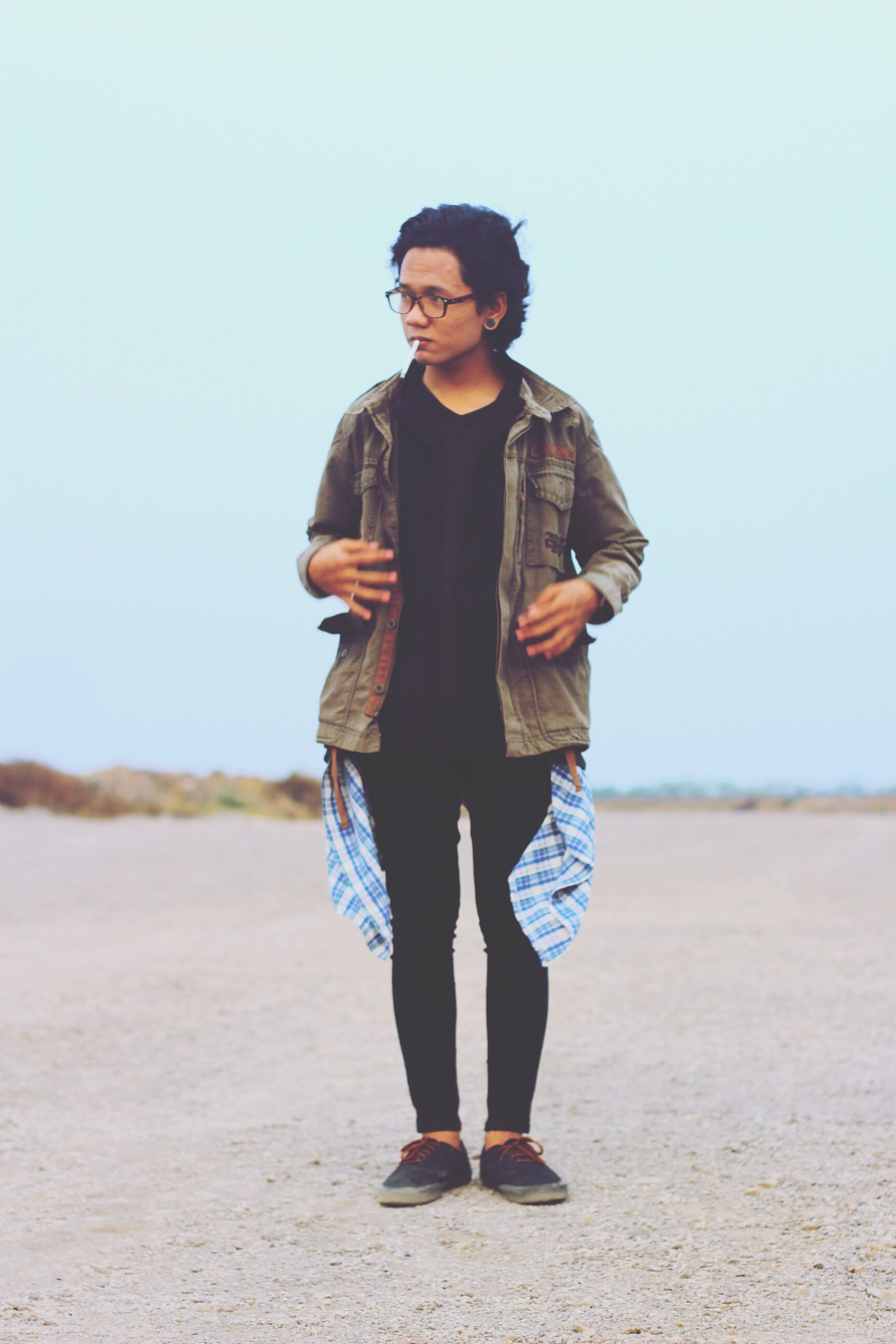 young adult, casual clothing, standing, lifestyles, front view, person, portrait, looking at camera, full length, young women, leisure activity, sunglasses, smiling, three quarter length, fashion, clear sky, day