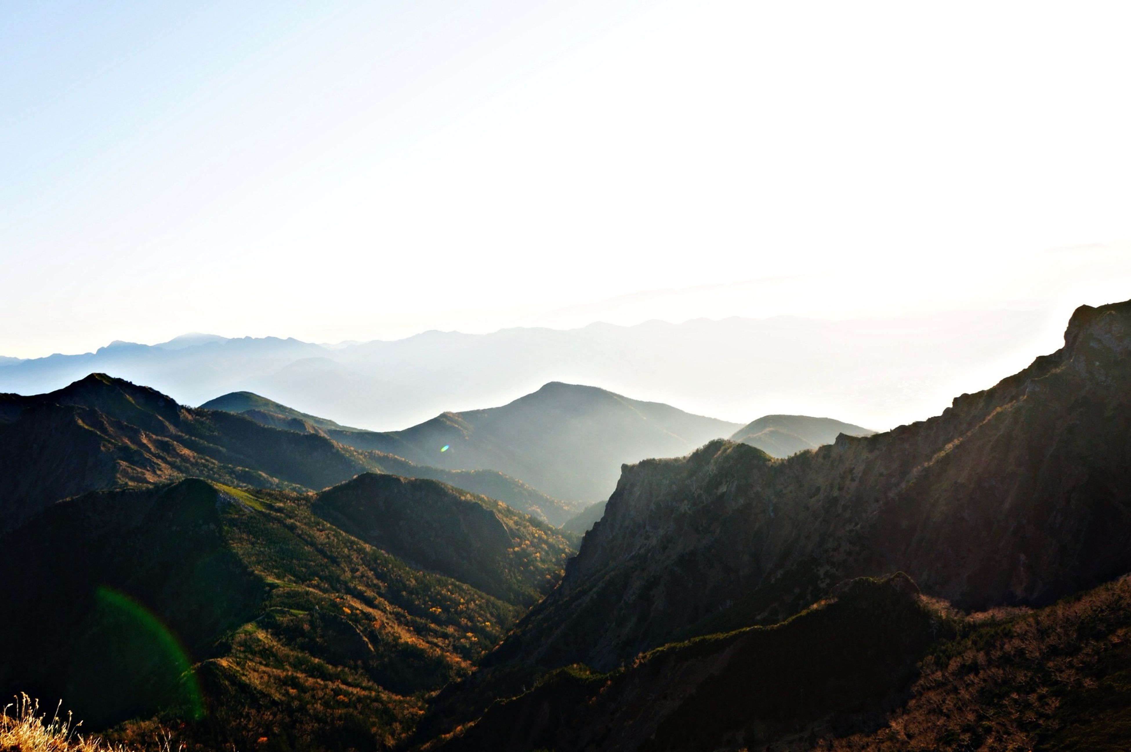 mountain, mountain range, tranquil scene, scenics, tranquility, beauty in nature, landscape, clear sky, copy space, nature, non-urban scene, idyllic, physical geography, geology, sky, remote, outdoors, hill, no people