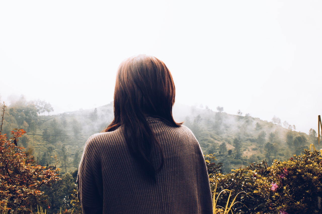 mountain, nature, real people, rear view, foggy, one person, fog, plant, growth, women, scenics, tree, beauty in nature, tranquility, landscape, outdoors, day, winter, young women, sky, young adult, people