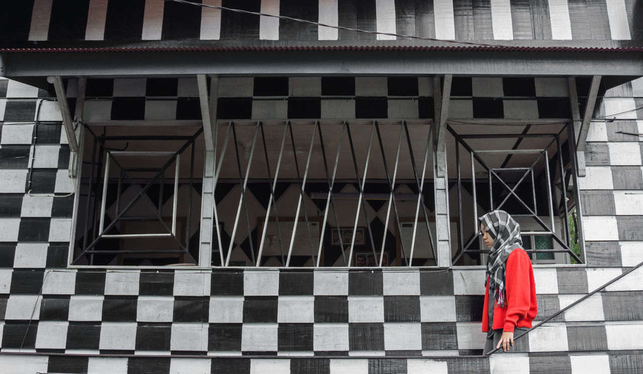 woman in red Adult Adults Only Architecture Building Exterior Built Structure Day EyeEmNewHere Full Length Lifestyles One Woman Only One Person Outdoors Pattern People Real People Rear View Red Streetphotography The Street Photographer - 2017 EyeEm Awards Women First Eyeem Photo
