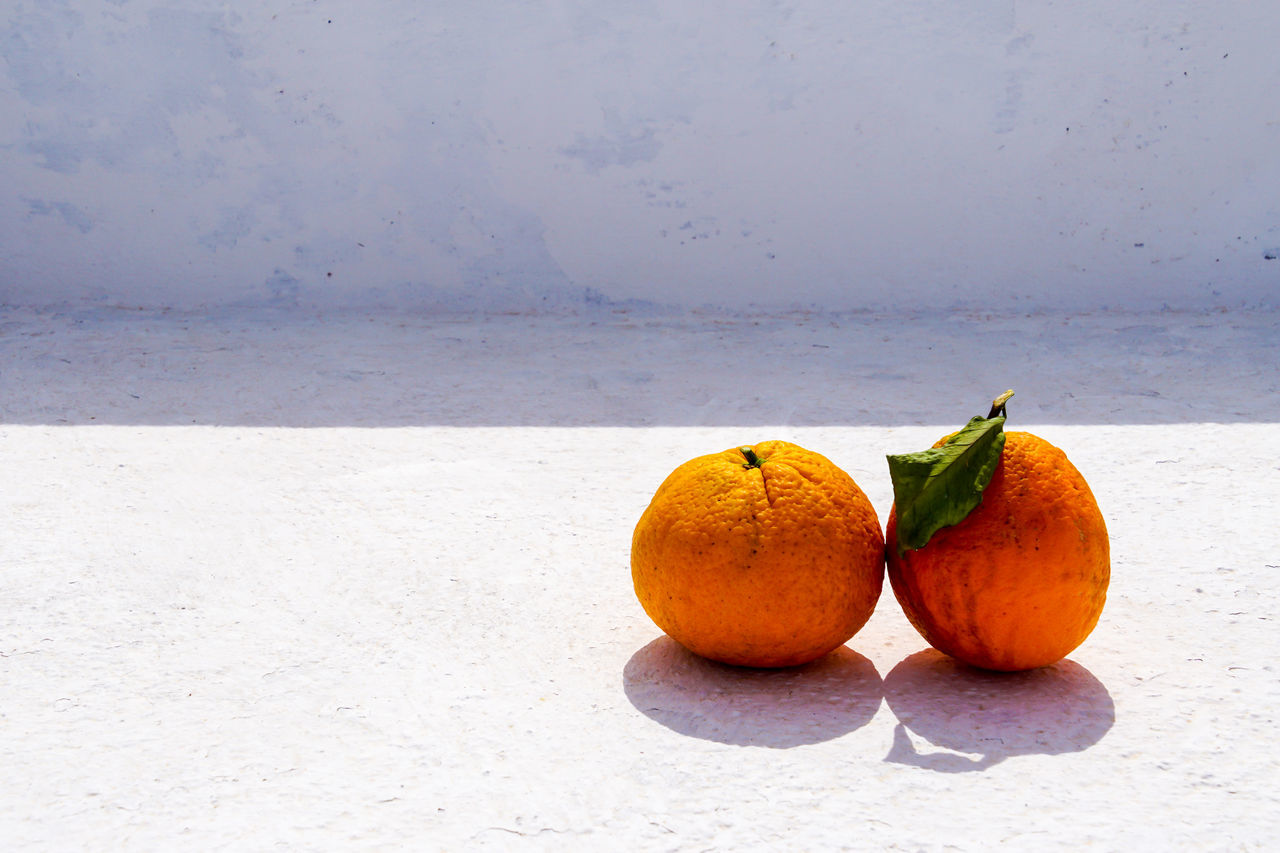 Close-up Day Food Food And Drink Freshness Fruit Healthy Eating Light And Shadow No People Orange Orange Color Outdoors Pair