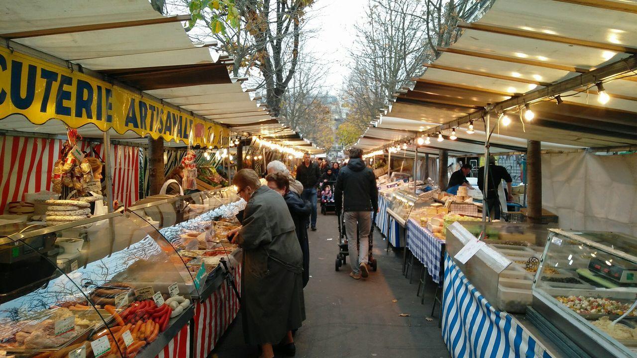 A Market. · Paris France Paris ❤ Farmers Market Food Produce Goods Errands Commerce People Stands Outdoors Winter Gray Sky Clouds