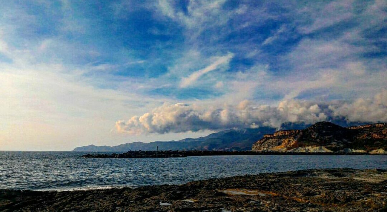 sky, scenics, sea, nature, beauty in nature, tranquility, no people, mountain, tranquil scene, outdoors, water, cloud - sky, day