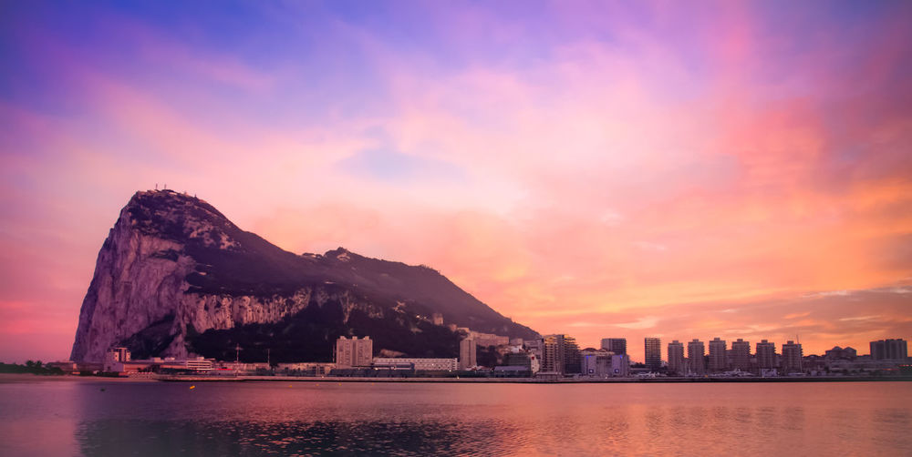 Amazing view of the rock of Gibraltar Colour Your Horizn Gibraltar Rock Architecture Beauty In Nature Building Exterior Built Structure City Day Mountain Nature No People Outdoors Scenics Sea Sky Sunset Travel Destinations Water Waterfront