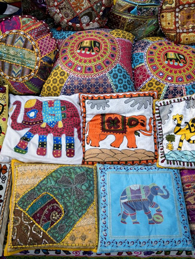 Colorfull cushions and quilts in Dubai souk. Dubai souk is a major tourist attraction. Attractions Tourism Local Market Souk Dubai Colorful Market Graphic Cushions  Quilts Quilt Squares