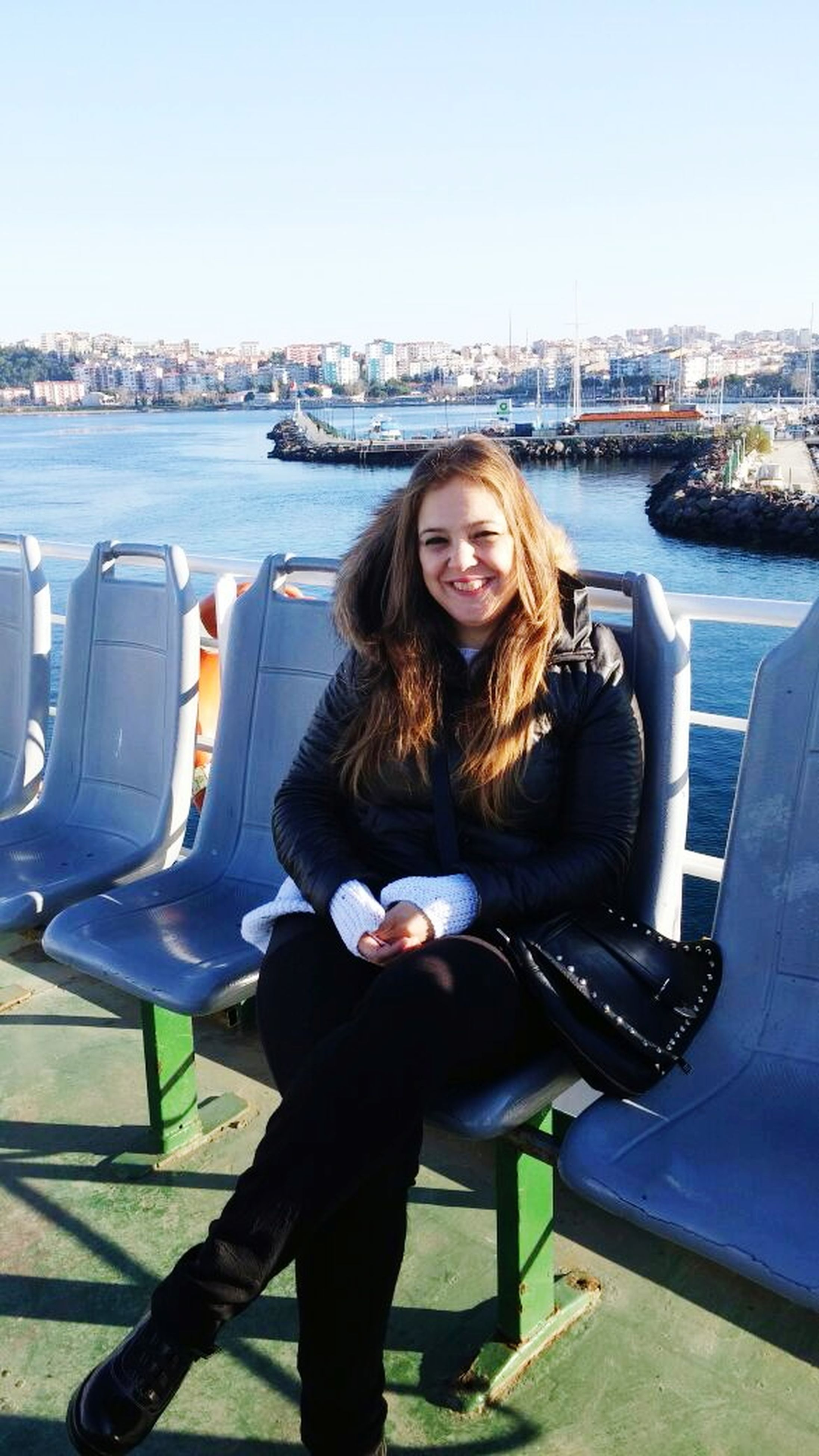 young adult, water, person, lifestyles, young women, leisure activity, casual clothing, portrait, smiling, sitting, looking at camera, sunglasses, long hair, transportation, nautical vessel, happiness, sea, waist up