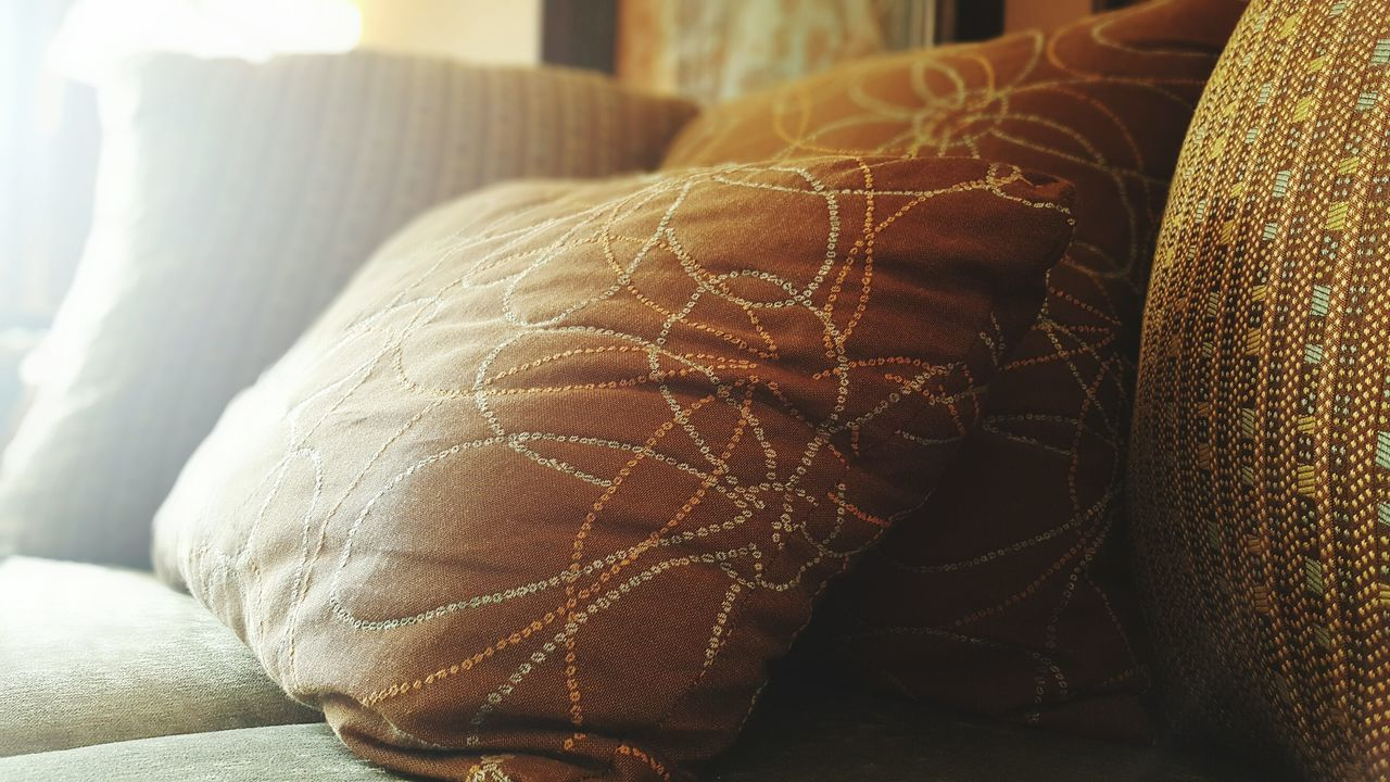 Close-Up Of Cushions On Sofa At Home