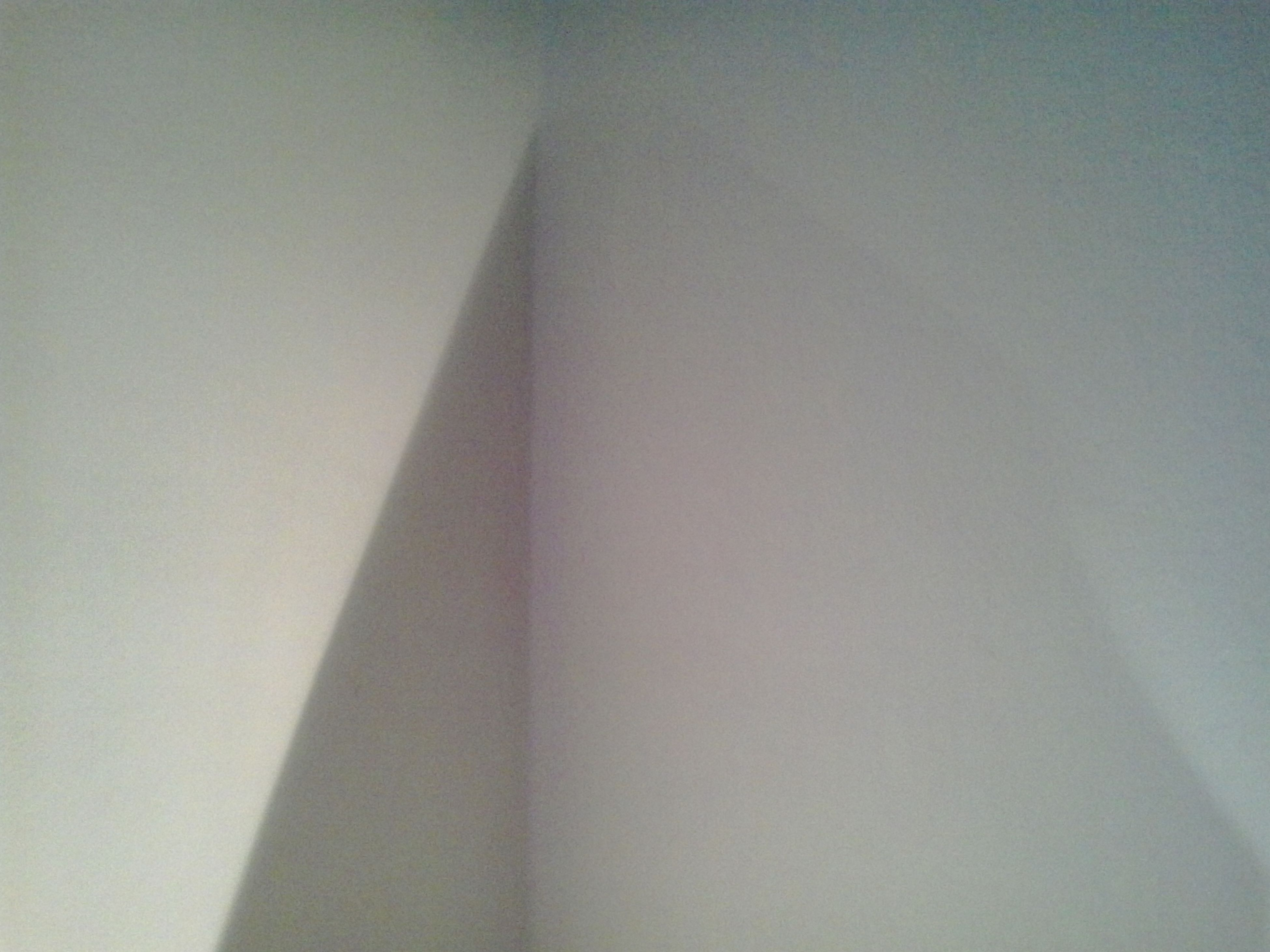 indoors, architecture, built structure, wall - building feature, low angle view, copy space, no people, wall, pattern, ceiling, shadow, sunlight, day, home interior, building, diminishing perspective, textured, design, backgrounds, white color