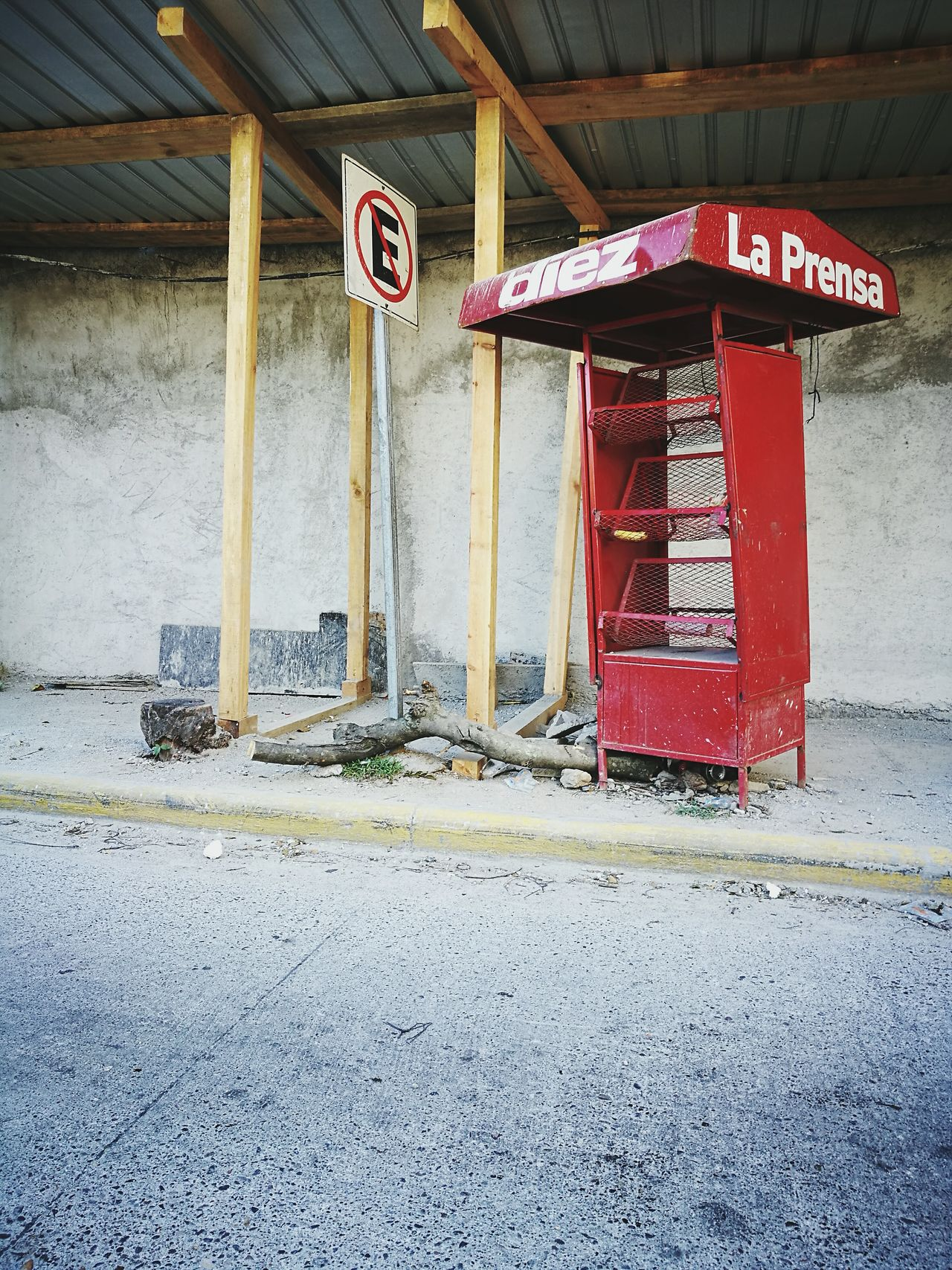 I was driving by a site that I usually pass on weekly basis and noted how badly damaged the news stand was. I swear it was in better condition last week I saw it Red No People Day Outdoors Architecture Newsstand No Parking Sign Construction Site