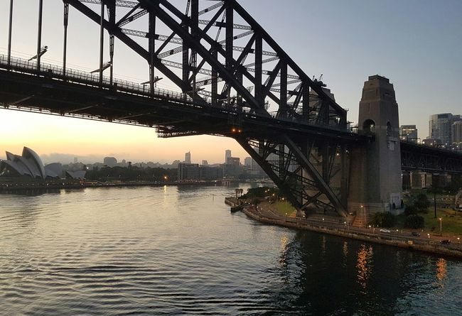 Bridge - Man Made StructureSydney Harbour Bridge Cruise Ship Sunset City Travel Destinations Travel Outdoors Harbor Cityscape Architecture Urban Skyline Vacations No People Water Sky Day Sydney Harbour Sydney Walsh Bay Sydney