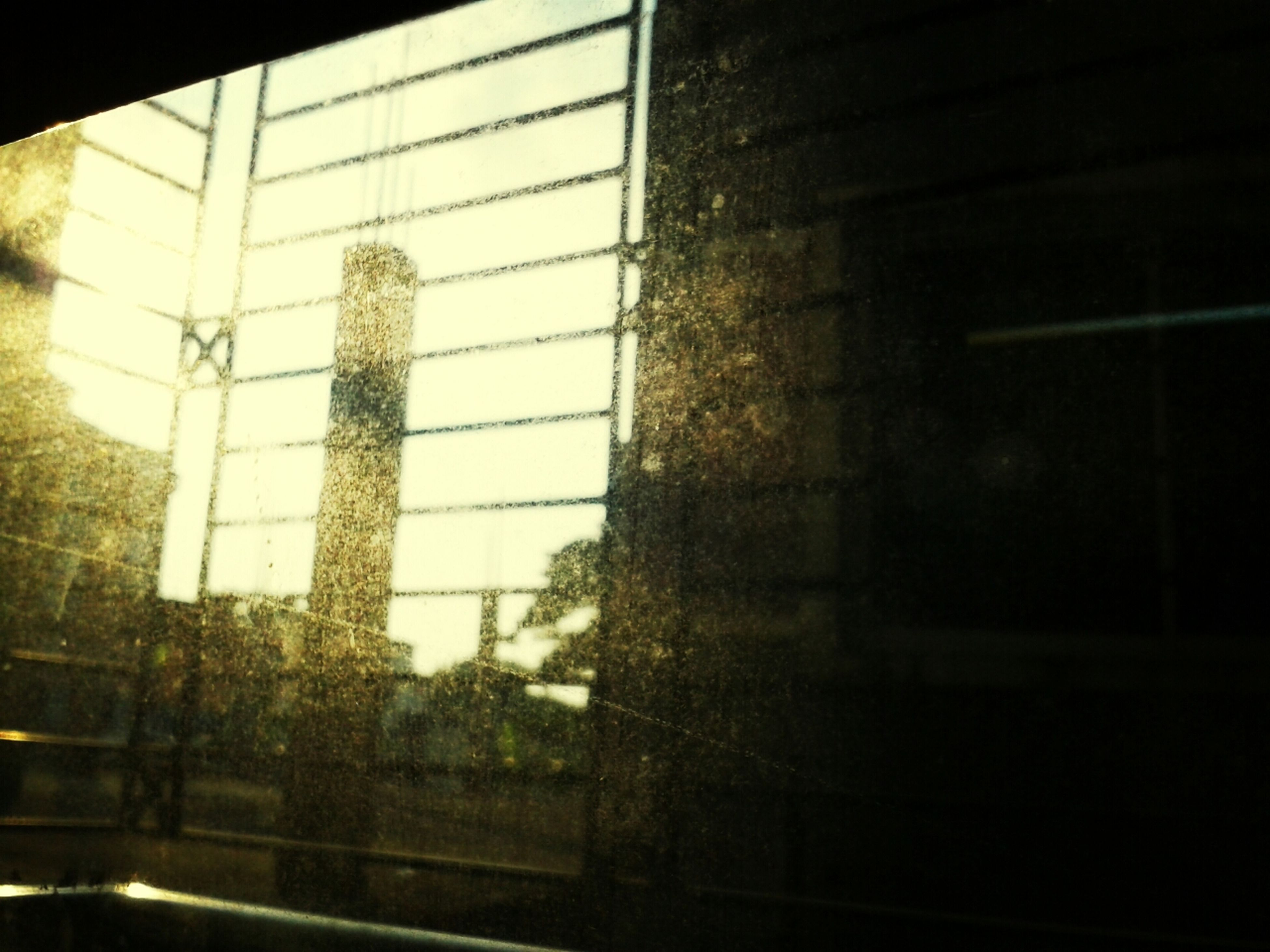 window, indoors, glass - material, transparent, built structure, architecture, reflection, building exterior, glass, looking through window, silhouette, no people, day, building, sky, low angle view, rain, wet, transportation, close-up