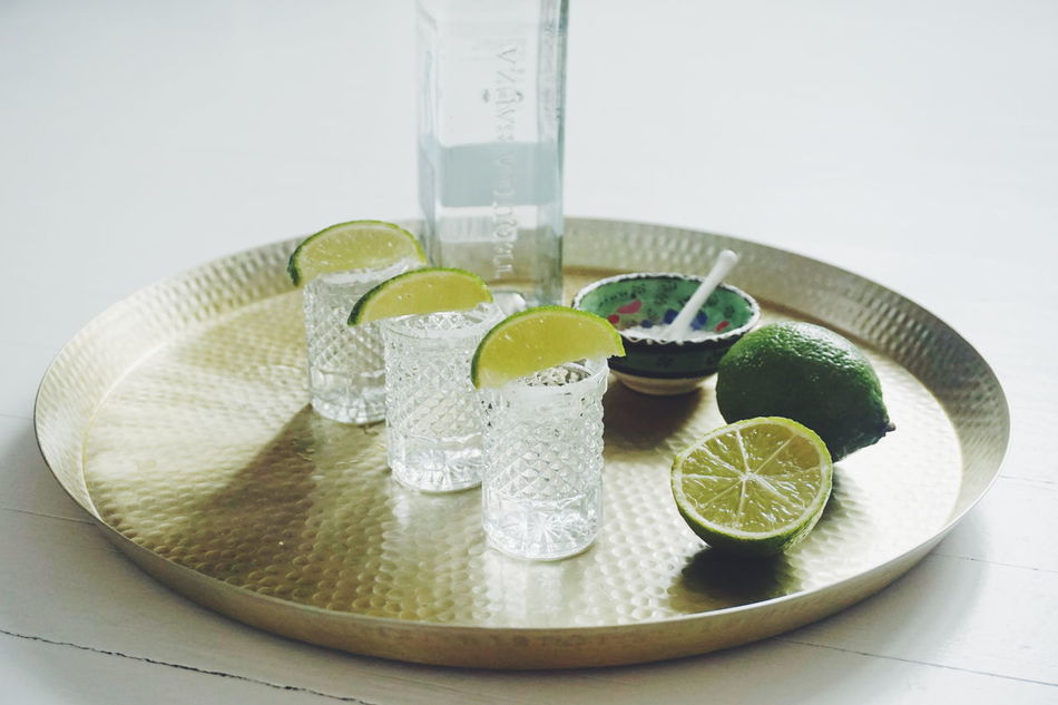 Cinco De Mayo Cincodemayo Close-up Day Drink Drinking Glass Drinks Freshness High Angle View Indoors  Lemon Lime Limes Mexican No People Salt Table Tequila Tequila Shots Water Tequila - Drink Refreshment SLICE