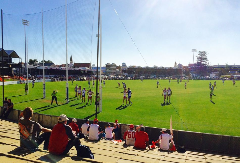 Footy Game at the Fremantle Oval Australian Footy Day Enjoyment Firl Flag Footy Footy Game Footy Oval Footy Players Fremantle Footy Fremantle, Western Australia Leisure Activity Lifestyles Men Outdoors Oval Playing Real People Recreational Pursuit Spectators Sport Sports Game Sporty Life Weekend Activities
