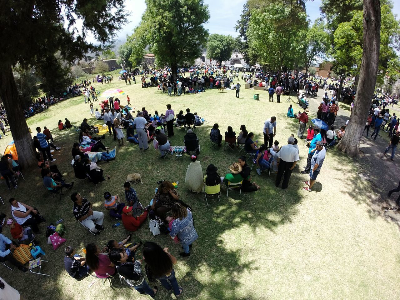 Tourists at the Santa Ana church atrium, during the Good Friday celebration. Fisheye Tourism Tzintzuntzan Michoacan Good Friday Religion Catholic People Overview Crowd Michoacan