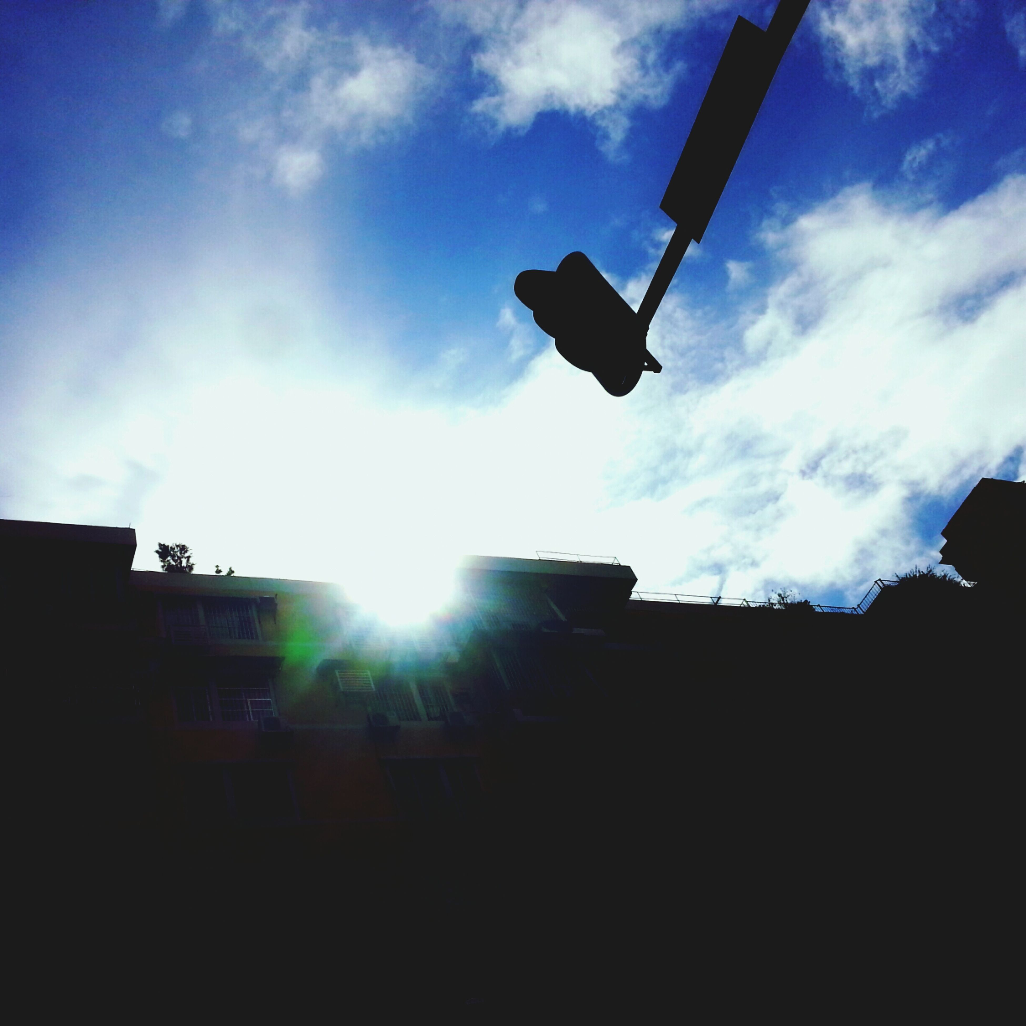 sun, sunbeam, silhouette, low angle view, sky, sunlight, lens flare, built structure, architecture, building exterior, cloud - sky, cloud, bright, back lit, sunny, day, outdoors, no people, nature, sunset