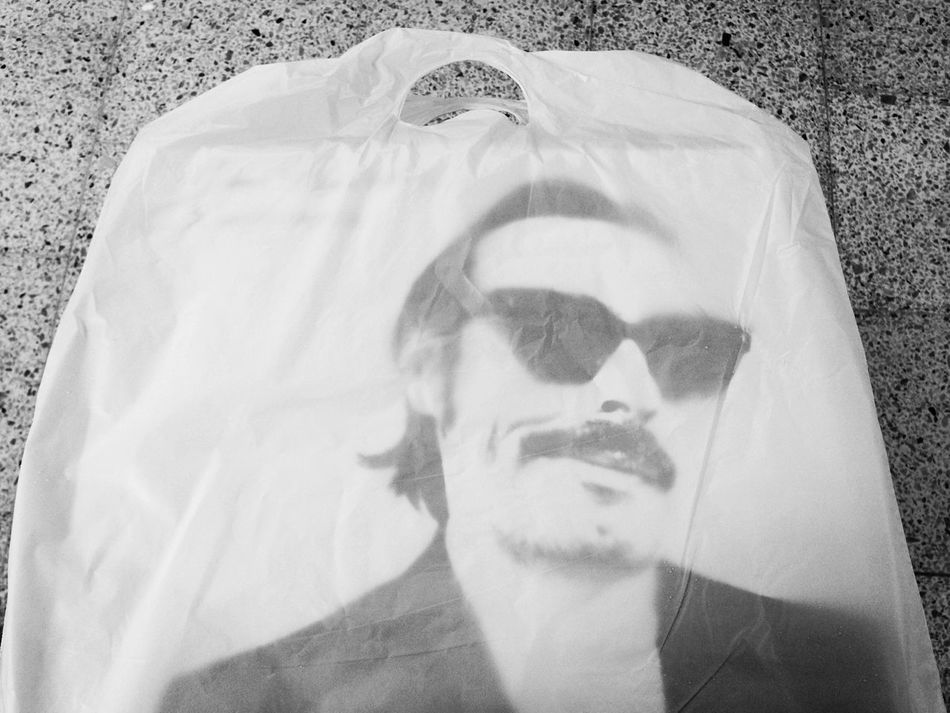 Blackandwhite Close-up Day Domestic Life Focus On Foreground Headshot Holding Human Face In The Bag Leisure Activity Lifestyles Looking At Camera LP LPs Music Person Personal Perspective Plastic Bag Portrait Purchase Rock Rocknroll Young Adult