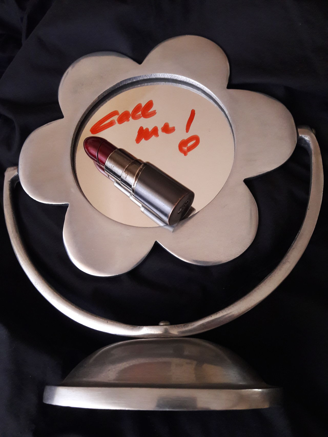 """Call Me"" Daisy Close Up Message Love Love Message Silver  Red Red And Silver Feelings Relationships Couple To Call To Phone Mirror Round Mirror Lipstick Communication Daisy Shapes No People Steel In Touch Keep In Touch  Black Background Conceptual social EyeEmNewHere"
