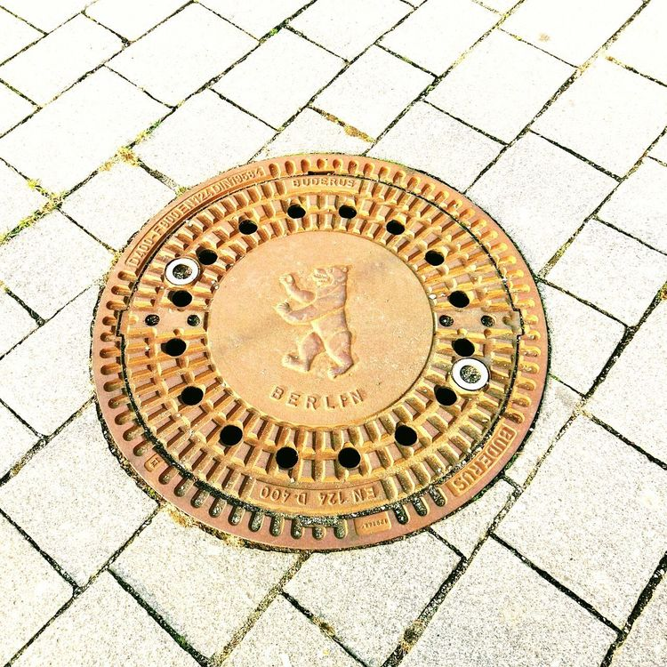 EyeEm Selects Manhole  Circle Sewage Sewer Pattern Outdoors Street No People Metal Grate Manholes In Berlin Berlin Bear Berlin Photography Berlindubistsowunderbar Urbanphotography